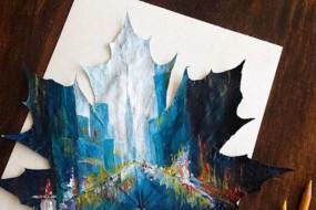 艺术家在落叶上画精美风景画