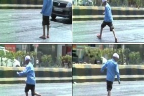 印度高温马路熔化粘掉行人鞋