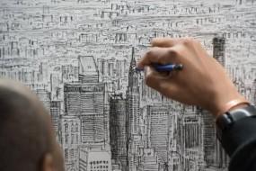 艺术家凭惊人记忆力画城市全景图